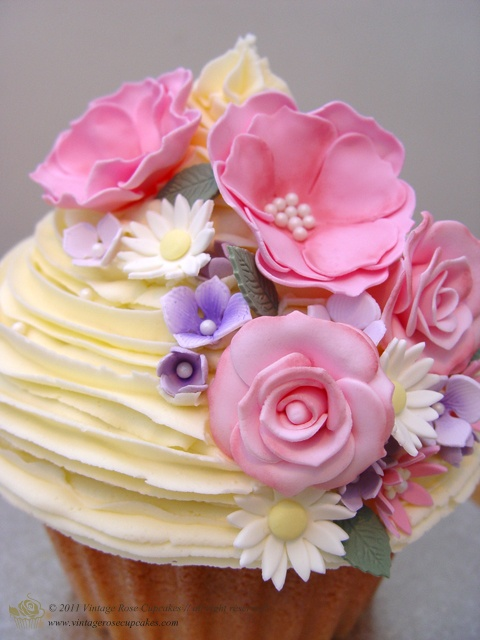 Giant Vintage Flowers Cupcake from vintagerosecupcakes.com. A truly stunning centre piece for any occasion. A plain delicious vanilla cake base that goes all the way to the cakes topping, it's all cake! Covered in vanilla butter cream and delicate handmade sugar paste flowers and peonies.