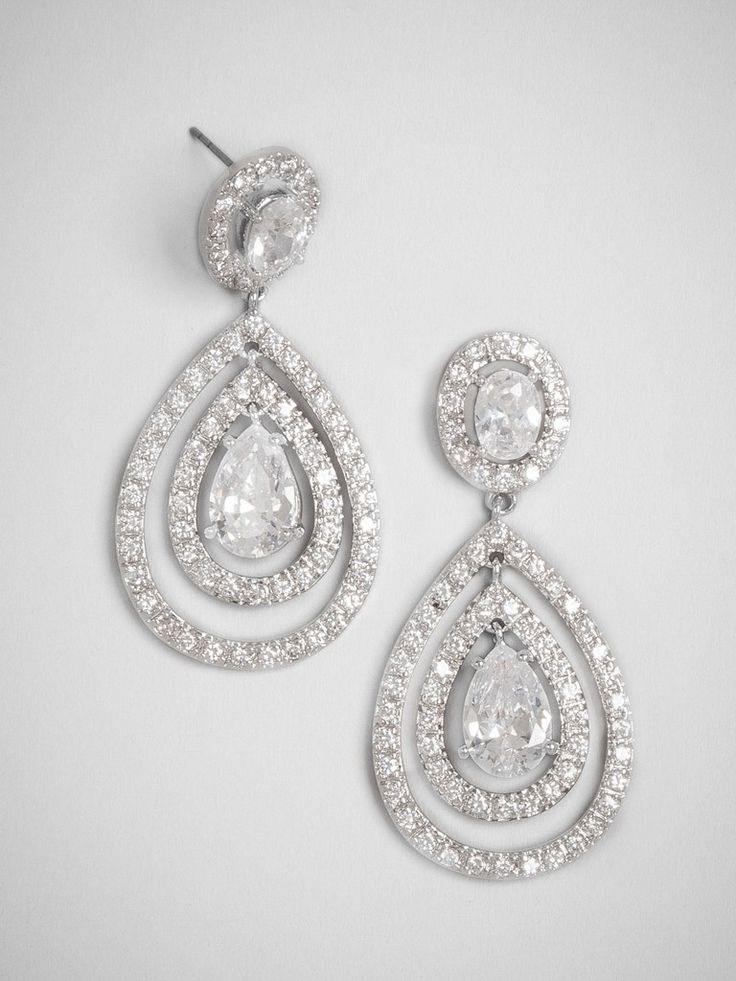 Light-catching statements with plenty of movement: Play off a gorgeous updo with these brilliant sparklers, designed around a regal teardrop-shaped crystal.