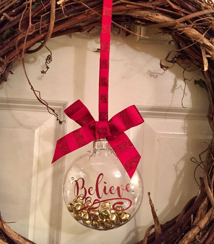 DIY Christmas ornament with Believe red glitter vinyl made on Cricut, bells inside and ribbon hanger. Reminds us of our favorite movie, Polar Express.