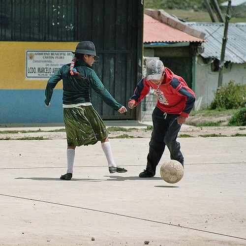girl playing soccer, Andes in Ecuador (analog photography)