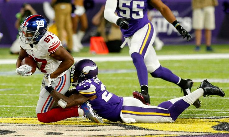Monday Night Football: Giants vs. Vikings:   October 3, 2016  -  24 - 10, Vikings  -    New York Giants wide receiver Sterling Shepard is tackled by Minnesota Vikings cornerback Captain Munnerly after making a reception during the first half of an NFL game, Monday, Oct. 3, 2016, in Minneapolis.