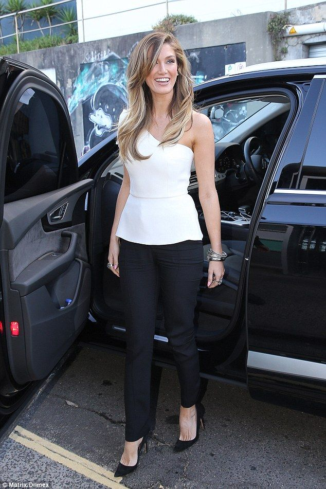Leggy lady: Delta Goodrem put on a leggy display in stylish trousers as she dined out in Sydney's Bondi with fellow Voice Australia judges Jessie J, brothers Joel and Benji Madden and Ronan Keating on Sunday