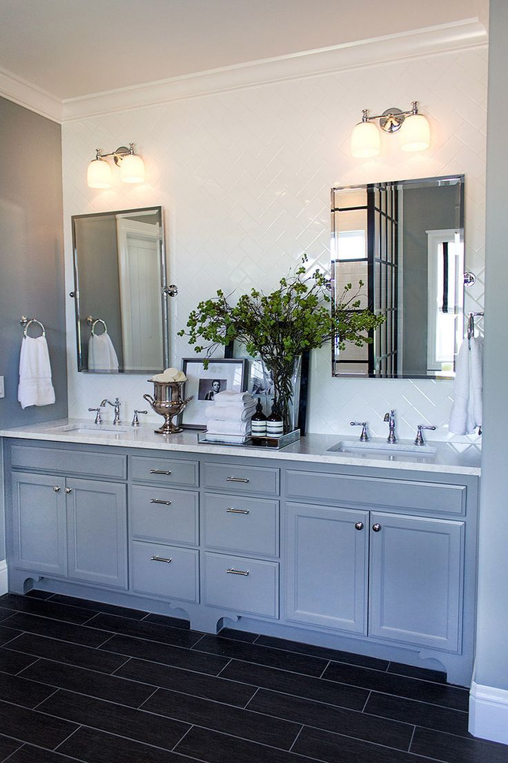 This blogger painted the walls a soft gray shade, and created a white subway tile accent wall, arranged in 90-degree herringbone, to accentuate the new double-sink vanity.