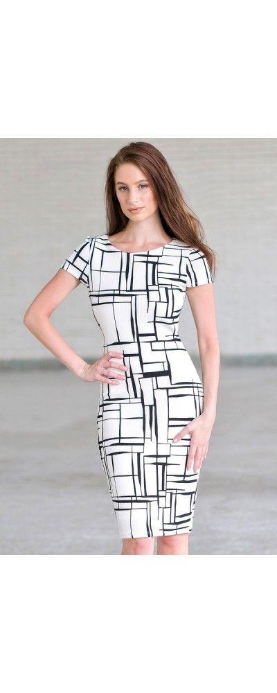 White maxi dress with black fleur de lis pattern