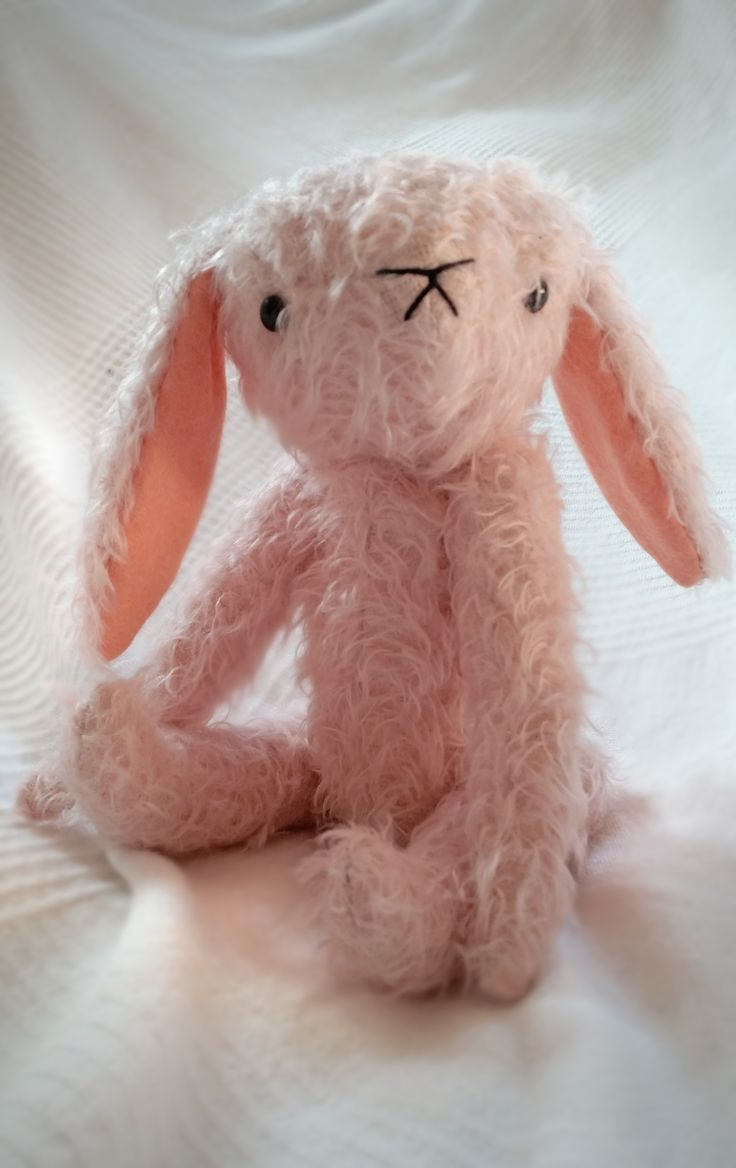 A 100% natural vintage inspired mohair bunny, fully articulated, natural wood wool and untreated cotton stuffing, wool felt ears, glass eyes. Would make a sweet gift. Size: 27 cm. Color: pale pink. Stitched by hand. Even though I made it as safe as possible, it is not suitable for children under 3 years of age.