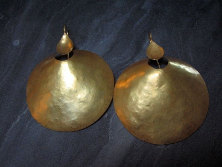 These hammered 18k gold earrings were made for us in India. The design is a beautiful tribal design . From India