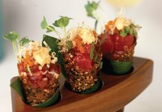 Spicy Tuna Tartare In Sesame Miso Cones -- 4 ounces diced # 1 sushi grade tuna, 1 tablespoon diced pickled ginger, 1 teaspoon chopped scallions, 1 tablespoon soy sauce/wasabi, 2 tablespoons Spicy, Chili Mayonnaise