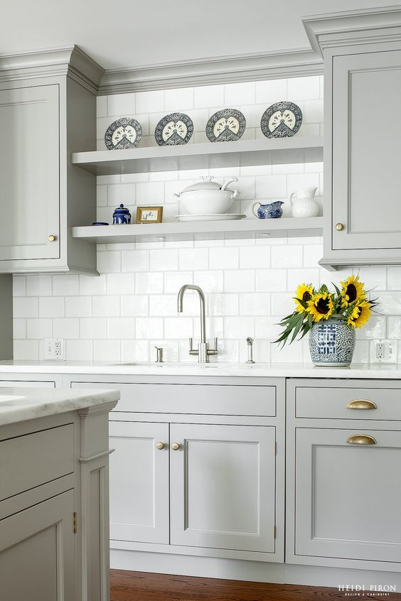 This elegant pale grey kitchen looks stunningly refined when paired with white tiling and worktops, and delicate chinaware. http://www.solidwoodkitchencabinets.co.uk