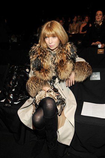 Anna Wintour - looking v Venus in Furs in a fur trimmed coat -