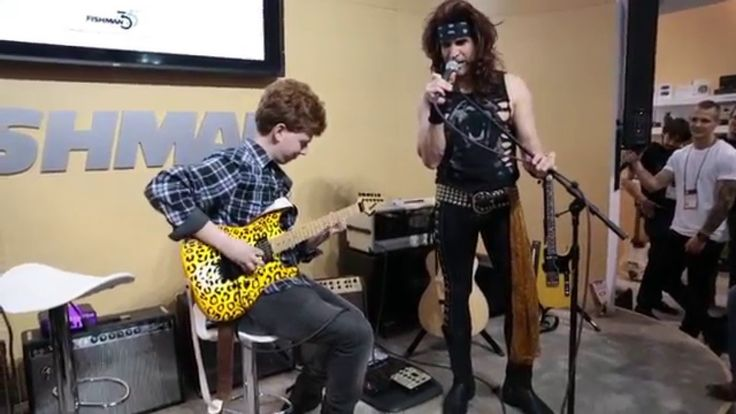 Russ Parrish aka Satchel lets a fan play his guitar at Fishman Pickups B...
