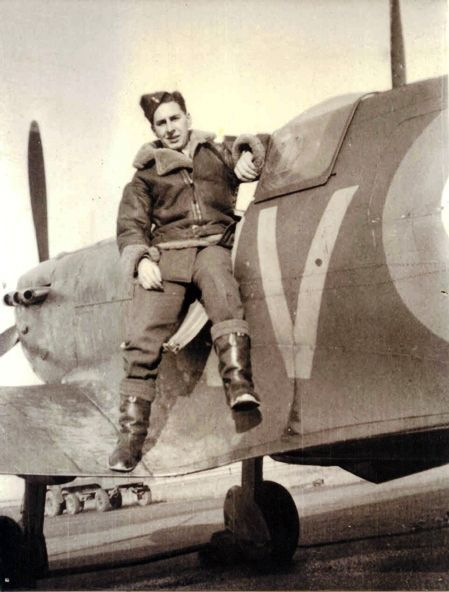 "Sgt Kenneth A ""Ken"" Wilkinson sits atop the cockpit of a Spitfire Mk I after reporting to No 19 Squadron RAF on 17 October 1940. At RAF Fowlmere, the self-styled ""odds-and-sods bloke"" befriended Sgt Bernard J ""Jimmy"" Jennings, with whom the 22-year-old pilot practiced formation flying and aerial combat. In existence for some weeks before his arrival, he surmised the virtues of the Duxford Wing as chiefly psychological to the enemy who had been led to believe the RAF were almost finished."