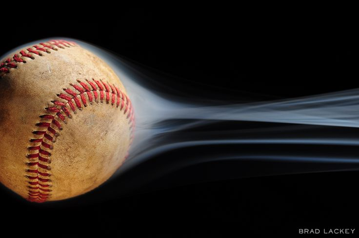 https://flic.kr/p/bvBHAh   Fast Ball   Website   Facebook   Instagram   Twitter   Strobist Info: Flagged LP160 at 1/4 power to illuminate the smoke and a bare SB-700 at 1/32 power pointed directly at the baseball (both fired via Cactus V5 triggers).  I waited to post this shot until today - MLB Opening Day 2012.  Other than the orientation, this photo is entirely SOOC - no Photoshop here.  Click here to see the setup.