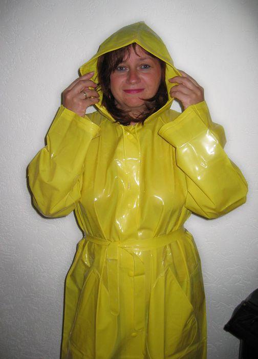 Cute PVC Rainwear Girl in a shiny yellow long Raincoat ...