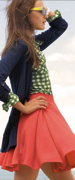 Cute coral skirt with a navy cardigan and green shirt. Flirty and happy kids:)