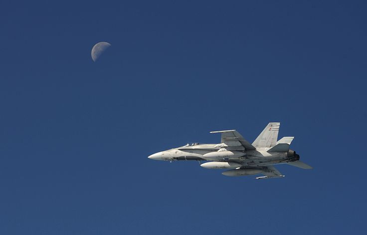 A Royal Canadian Air Force McDonnell Douglas CF-18 Hornet flies in the Alaskan airspace during Exercise VIGILANT EAGLE on August 28, 2013.