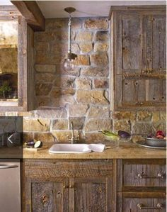 river rock backsplash kitchen