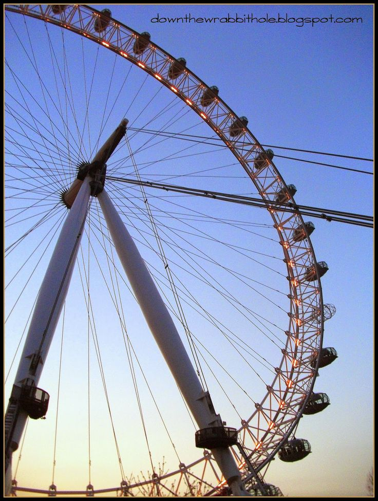 """Ride the London Eye during twilight. Find out more at """"Down the Wrabbit Hole - The Travel Bucket List"""". Click the image for the blog post."""