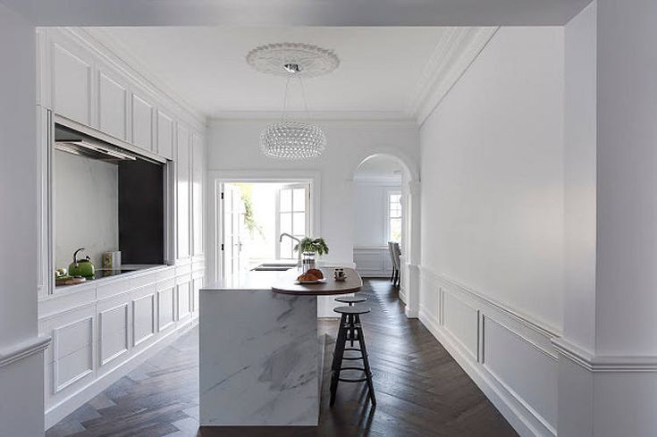 """Is it a minimalist's dream kitchen or the lazy cook's ultimate """"shove the mess behind the ..."""