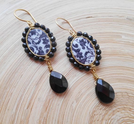 Stylish, eye-catching and unique, Edna is a pair of earrings that surely possess a sort of wow factor. The focal element of Edna earrings is an oval mother of pearl bead with a black and white paisley laser-etched pattern that will not fade over time. This mother of pearl oval bead