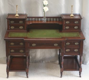 Victorian Writing Desk. Lots of drawers and places to put books. I like it!