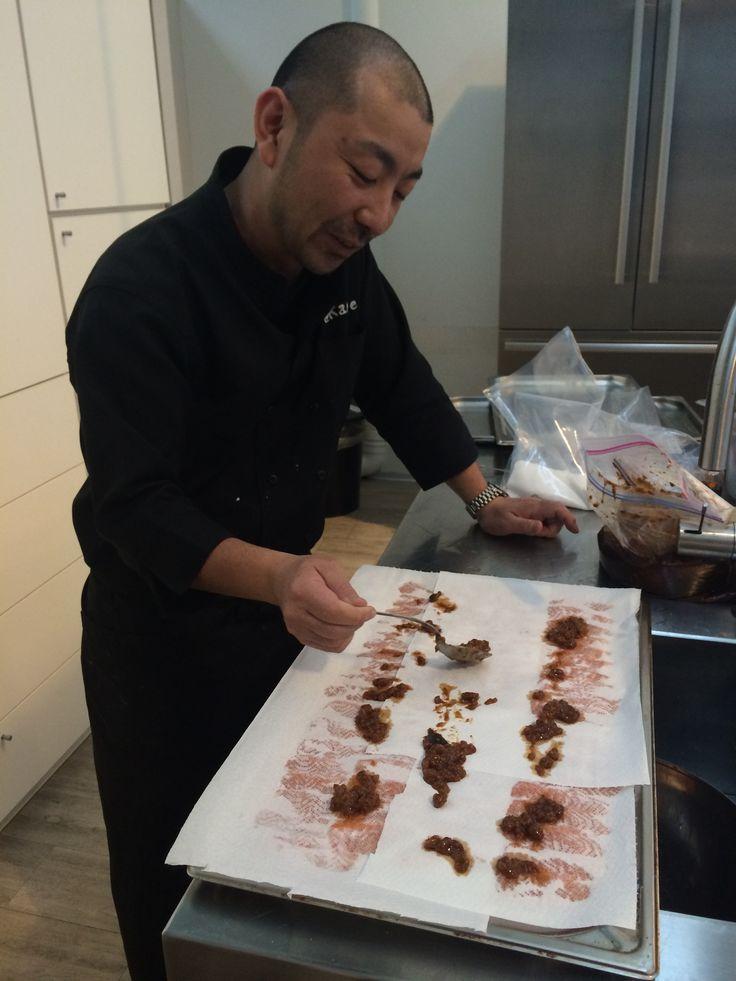 Chef Fushiki marinating salmon. Chef Fushiki collaboration dinner with casa Vinicola Zonin.