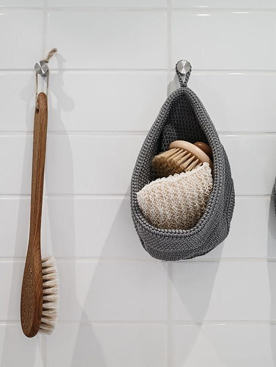 No at-home spa is complete without the tools of the trade. Invest in a bath brush, loofah or natural sea sponge that can double as decor. In this bathroom from Stadshem, these essentials are hung on the wall so they're always within reach.