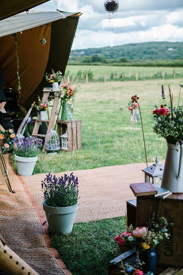 Bohemian Outdoor Tipi Wedding Flowers Ladder Jugs  http://www.sarahjanesphotography.co.uk/