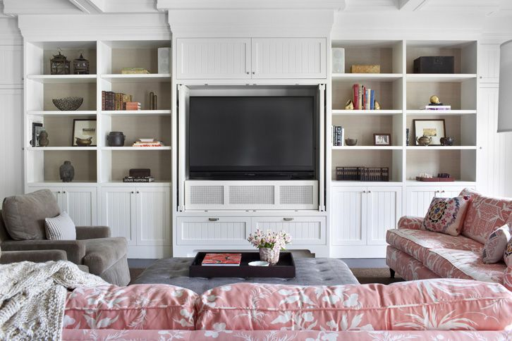 White built-in media center backed with grasscloth, pink chinoise sofas, mik gray club chairs | Betsy Burnham