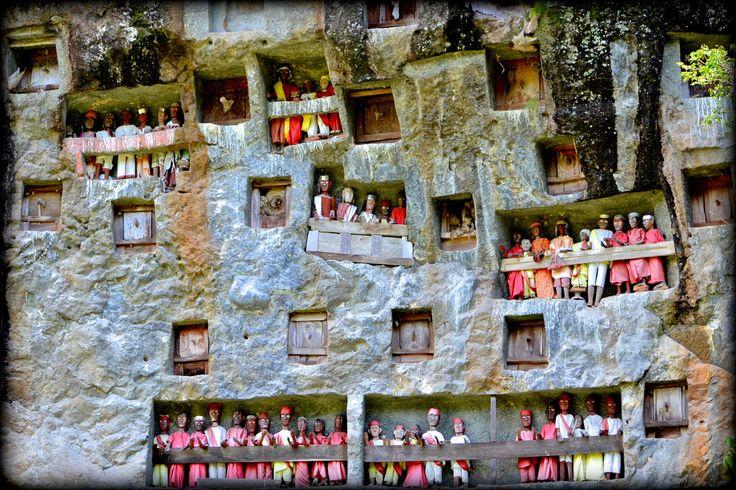 https://flic.kr/p/v1AV9C | Lemo - Stone Graves | Batu Lemo, Tana Toraja Place of burial or funeral bodies shaped holes in the wall rock and Tau tau (effigies of the deceased) ....