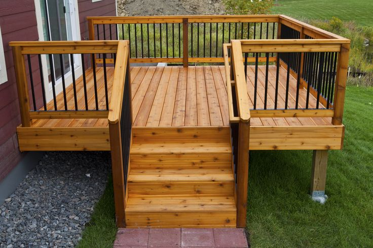 Simple, relatively inexpensive cedar deck with aluminum hybrid rails. Built by Deck And Basement Company.