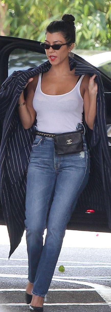 Who made Kourtney Kardashian's black pumps, blue jeans, blue stripe coat, and gold jewelry?