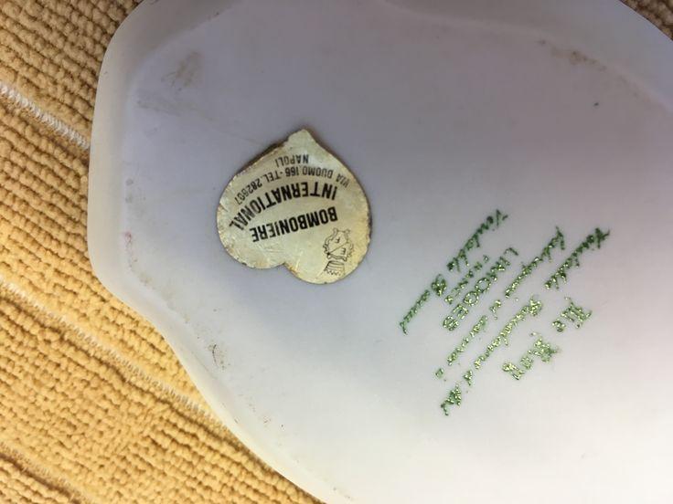 Information on bottom of tray including retailer sticker (Napoli).