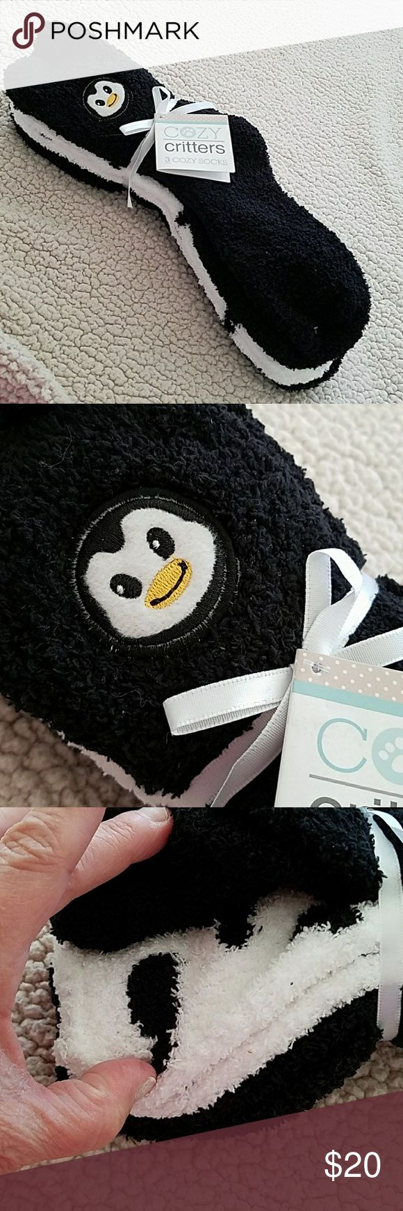 Women's Cozy Critters 3 Pairs Of Ankle High Socks This is for three pairs of brand new women's Cozy Critters ankle high cozy socks. One is black with a penguin on it the other is white with black in color hearts and the other pair is solid black. In case you would like to give these as a gift inside the Cozy Critters card is a to and from form. Cozy Critters Accessories Hosiery & Socks