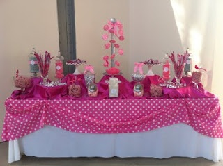 pink table cloth and platform setting