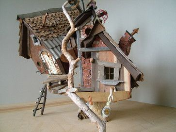 crooked creations - Two birdhouses on one stump. Al recycled materials. Lights up at night