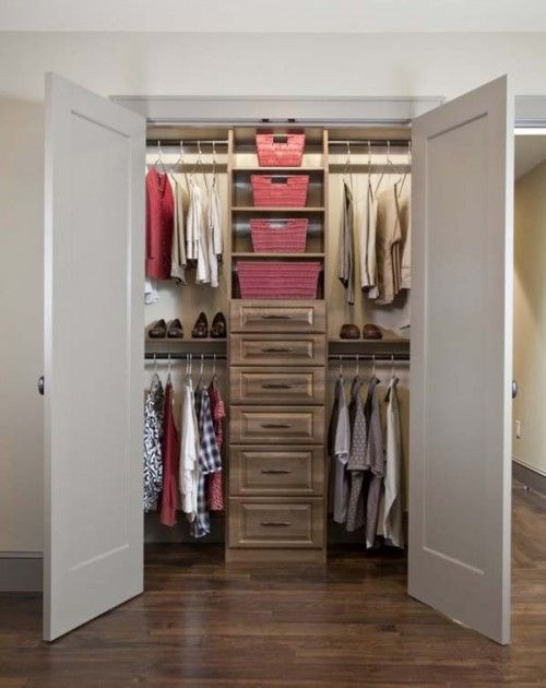 Organized small closet: could solve the no room for a dresser problem in Emma's room.