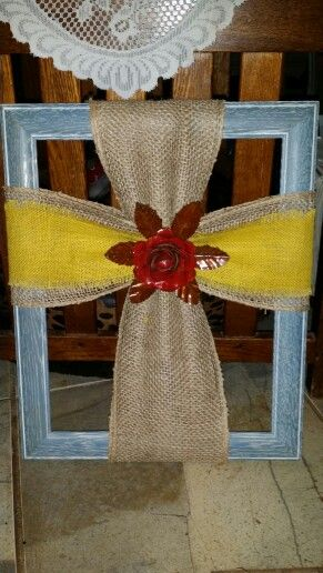 Old picture frame, burlap cross with large red metal flower