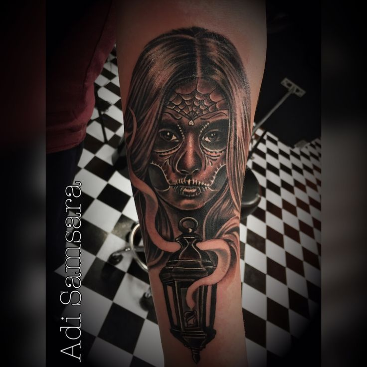 Black and grey muerte tattoo