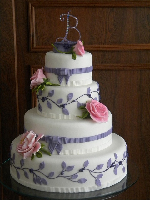 possible wedding cake with the last name's first letter on the top