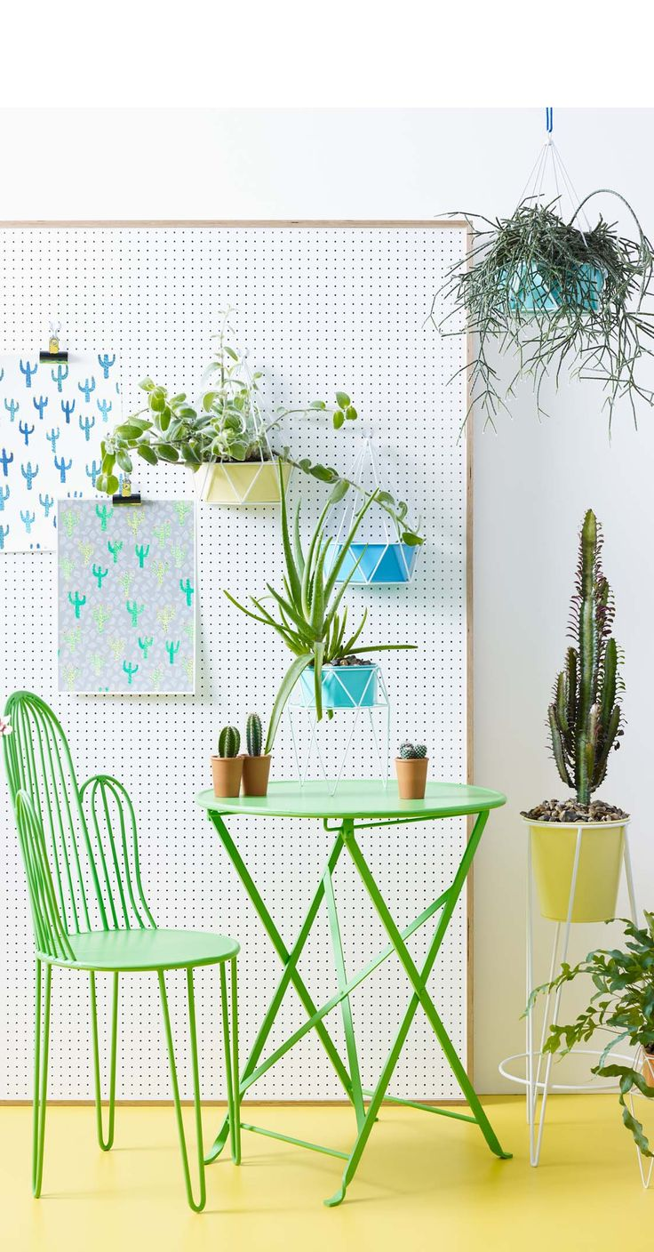 Go green and let your indoor garden take shape with this Yellow Geo Tall Planter.
