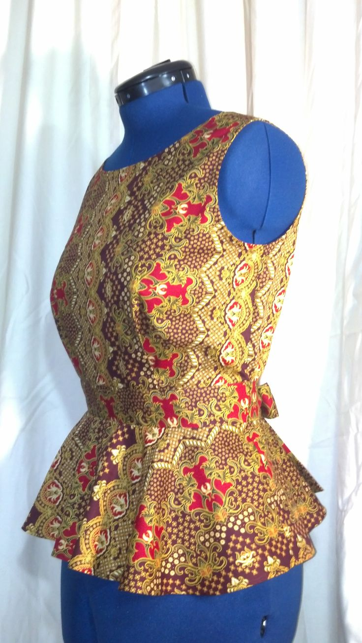 Batik Peplum top with adjustable tie back.