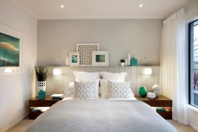 This inspiring master bedroom oozes a cool retro feel with a striking white palette and injections of blue and green vases and retro artwork. Low line furniture and contemporary pendant lights add to this Californian style. As displayed in Montague 21 at Grandvue Estate.