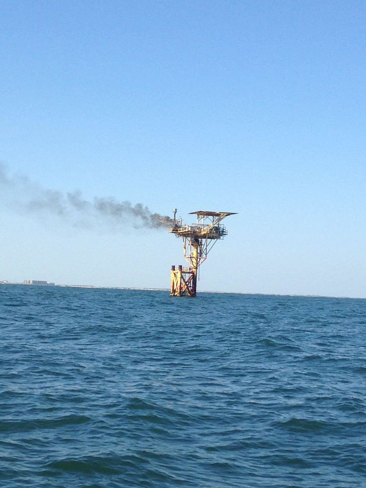 Coast Guard responds to platform fire near Corpus Christi Texas A Magellan platform on fire approximately three miles off Bob Hall Pier near Corpus Christi Texas March 7 2018. A Coast Guard Station Port Aransas boat crew was launched to the platform and enforced a 300-yard safety zone.  U.S. Coast Guard photo. by Coast Guard News