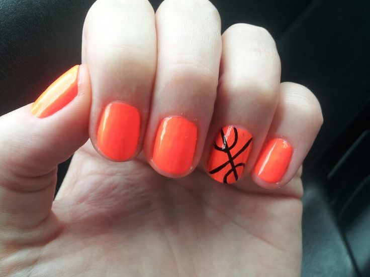 I'm so going to do my nails like this for basketball!!