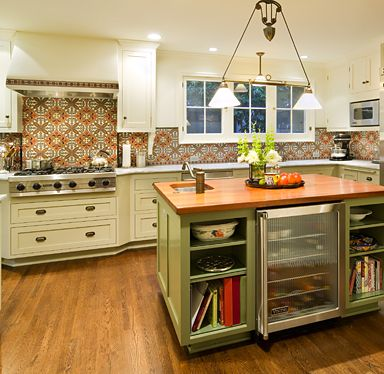 Love the backsplash and the green island with the open shelves and butcher block top. Oh, and the wood floors and creamy cabinetry too {Ann Sacks}