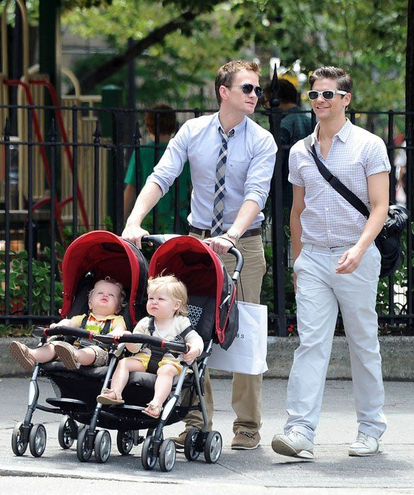 It's Neil Patrick Harris and David Burtka!  Two-year-old twins Gideon and Harper go for a stroll-er with dads Neil Patrick Harris and fiancé David Burtka.