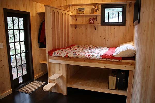 """small space living in a tiny home. Cool bed and storage without a loft or ladder in this tiny house"""
