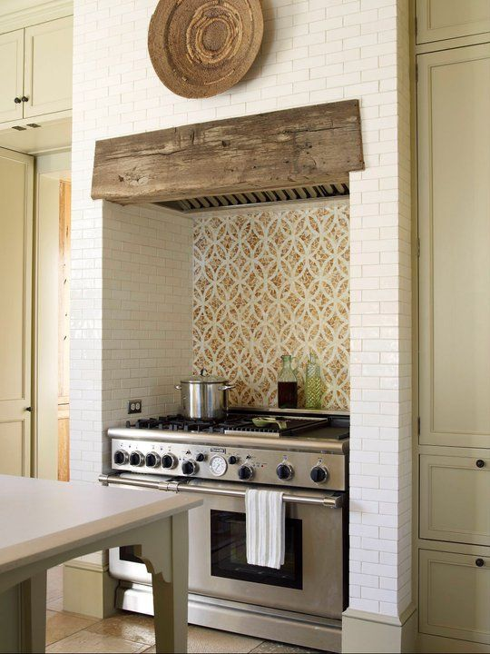 Like the brick surround (texture, not design) and the barn beam.   Do not like the backsplash--KG    Phillip Sides ... range niche