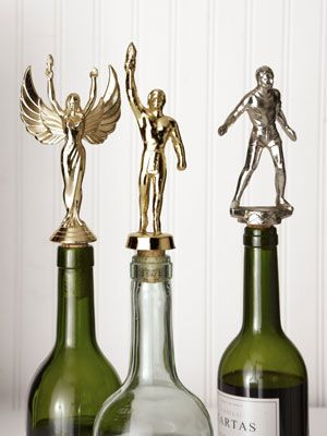 Turn those OLD TROPHIES into BOTTLE TOPPERS!  How CLEVER!!!  :)