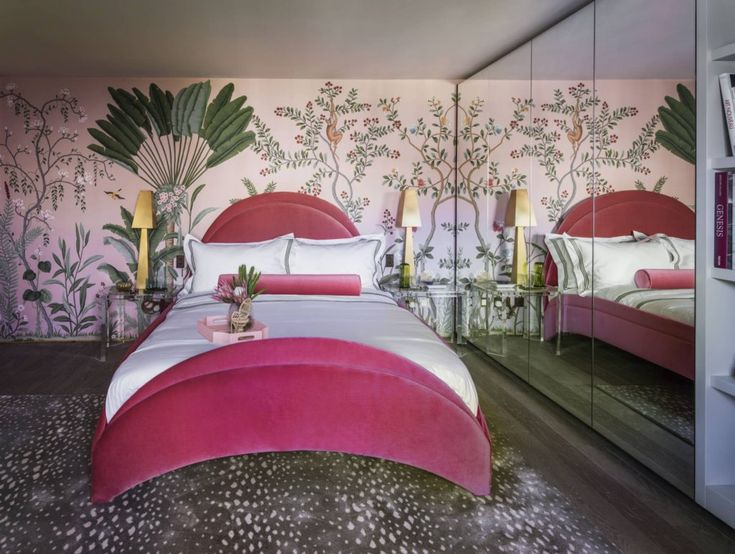 Holiday House London - The lovely Amelia Carter of Amelia Carter Interiors had created an luxe and exotic bedroom on the top floor. Cleverly using mirrored wardrobe doors along one wall to add light and depth to the space, and a gorgeous tropical foliage wallpaper by masters De Gournay framing the curved upholstered headboard, this felt both an indulgent and relaxing environment.